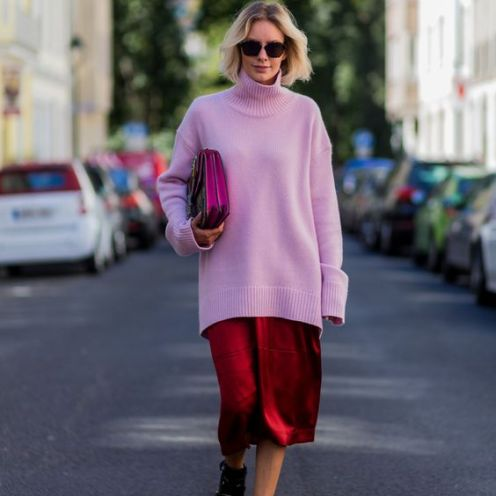 DUESSELDORF, GERMANY - AUGUST 25: Fashion blogger Lisa Hahnbueck (@lisarvd) wearing Dior Abstract sunglasses, a pink Celine Cashmere Turtle Neck, red Celine Silk Pants, black Balenciaga Boots, Gucci Dionysus Bag on August 25, 2016 in Duesseldorf, Germany. (Photo by Christian Vierig/Getty Images) *** Local Caption *** Lisa Hahnbueck